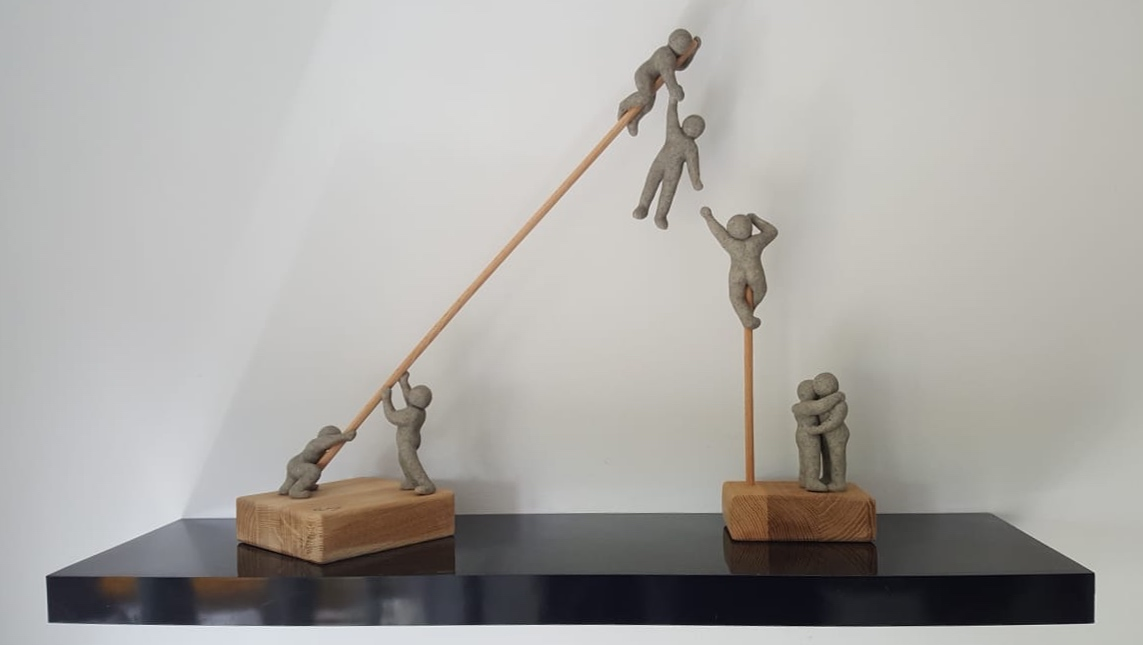 clay men on poles